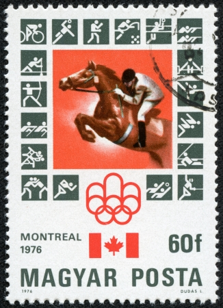 HUNGARY - CIRCA 1976  A stamp printed in Hungary, shows Montreal Olympic Emblem, Canadian Flag, Equestrian, with inscription and name of series  Olympic games in Montreal, 1976 , circa 1976