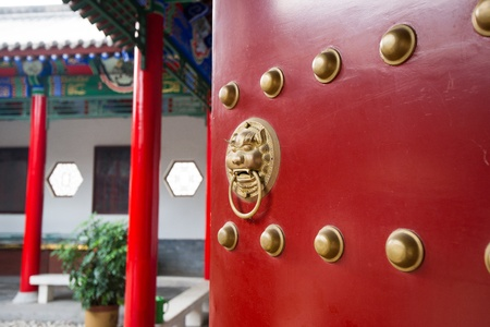ancient red doors in the  temple,Xian, China photo