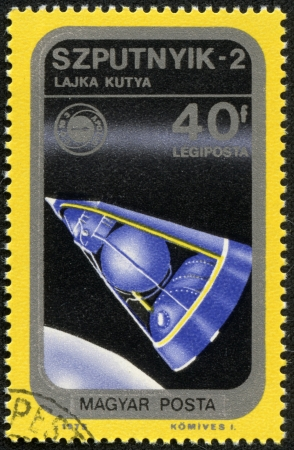 magyar: HUNGARY - CIRCA 1975   A stamp printed in Hungary, presents Sputnik, the second spacecraft launched into Earth orbit, on November 3, 1957, carry a living animal, a dog named Laika, circa 1975
