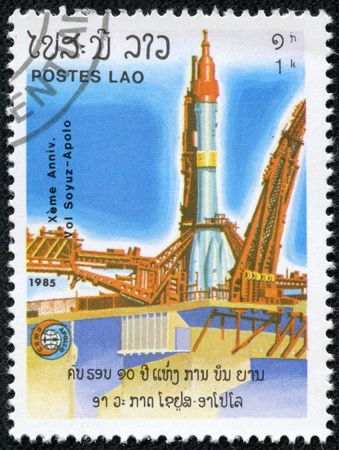 soyuz: LAOS - CIRCA 1985  A stamp printed in Laos shows Soviet rocket on launch pad with inscription and name of series  10th Anniversary of Apollo-Soyuz Space Link , circa 1985 Editorial