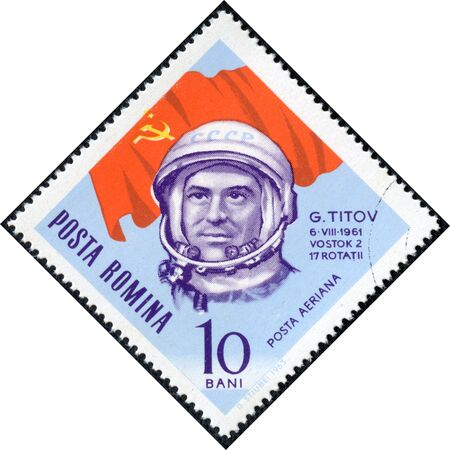 ROMANIA - CIRCA 1963  A stamp printed in Romania shows USSR flag and portrait of astronaut Gherman Titov, with the same inscription, from the series  Space Navigation , circa 1963