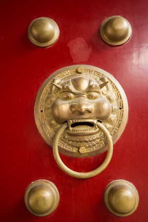 ancient red doors with gilded studs and lion head door knockers Stock Photo - 22978974