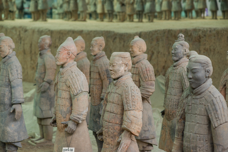 XIAN,CHINA -August 23  The Terracotta Army or the  Terra Cotta Warriors and Horses  buried in  pits next to the Qin Shi Huang s tomb in 210-209 BC  August 23, 2013 in Xian of Shaanxi Province, China Stok Fotoğraf - 22434490