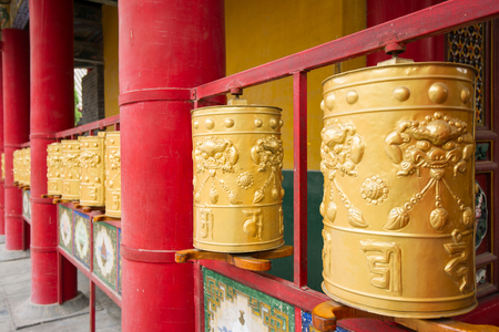 Buddhist prayer wheels photo
