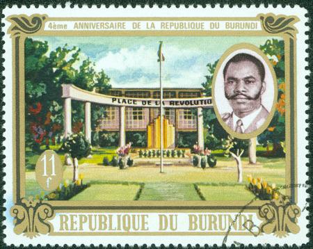 burundi: BURUNDI - CIRCA 1967  A stamp printed in Burundi shows Place de la Revolution and President Michel Micombero, with the inscription and name of series  1st anniversary of Burundi Republic , circa 1967