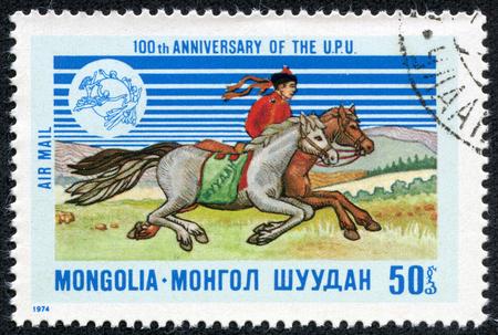 mongolia horse: Mongolia - CIRCA 1974  a stamp printed in the Mongolia shows Mongolian dispatch rider  UPU Emblem, circa 1974