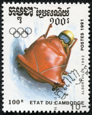 bobsled: CAMBODIA - CIRCA 1991  A stamp printed by CAMBODIA shows bobsled  Winter Games in Albertville 1992 series, circa 1991