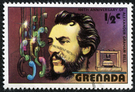 GRENADA - CIRCA 1980  A stamp printed in Grenada shows Alexander Graham Bell  1847-1922 , telephone, circa 1980 photo