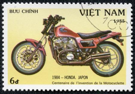 VIETNAM - CIRCA 1985  A stamp printed in Vietnam shows image of a vintage motorcycle, 1984 - Honda  Japan , circa 1985 photo