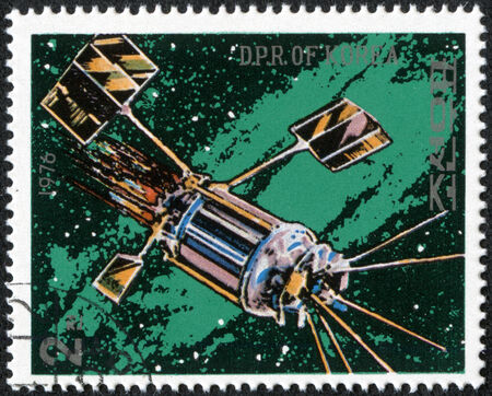 space station: NORTH KOREA - CIRCA 1976  A stamp printed in North Korea shows a space station against a sea of stars and the Milky Way galaxy, circa 1976  Stock Photo