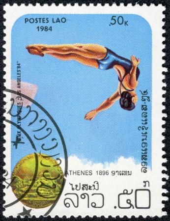 LAOS - CIRCA 1984  stamp printed by Laos dedicated to Olympics 84, dive or jump, circa 1984