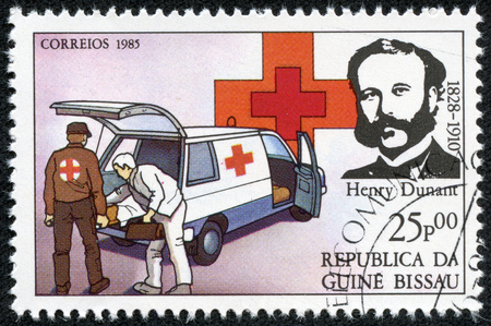 founder: GUINEA BISSAU - CIRCA 1985  A stamp printed in Guinea Bissau shows Henry Dunant, founder of the Red Cross charity, circa 1985 Editorial
