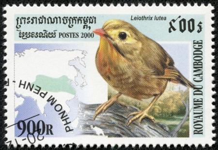 CAMBODIA - CIRCA 2000  A stamp printed Cambodia shows bird leiothrix lutea , circa 2000 Editorial