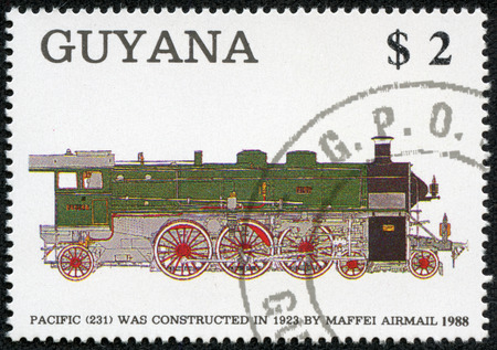 GUYANA - CIRCA 1988  A stamp printed in Guyana shows railroad locomotives 1923, circa 1988