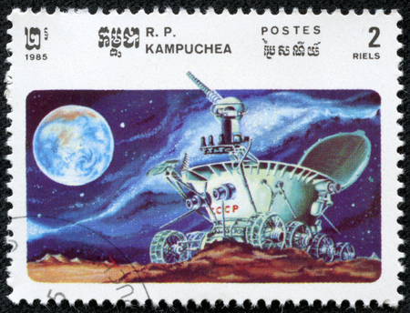 Cambodia - CIRCA 1985  A stamp printed in the Cambodia shows moonwalker explores the lunar craters, circa 1985  Big space series