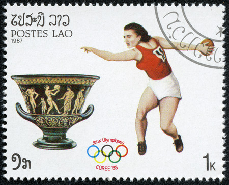 LAOS - CIRCA 1987  A stamp printed in Laos shows an athlethe javelin throwing, series Olympic Games in Seoul 1988, circa 1987