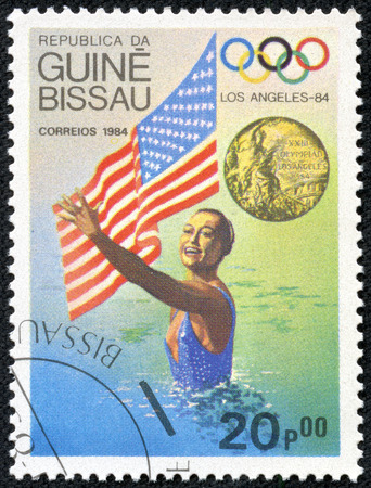 coherence: GUINEA-BISSAU - CIRCA 1984  A stamp printed in Guinea-Bissau showing Synchronized swimming athletes,The Los Angeles Olympics 1984,circa 1984