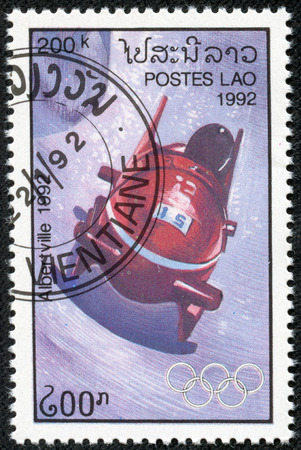 the olympic rings: LAOS - CIRCA 1989  stamp printed by Laos, shows bobsled and Olympic Rings, with inscription  Albertville, 1992 , from the series  Winter Olympic Games, Albertville, 1992 , circa 1989