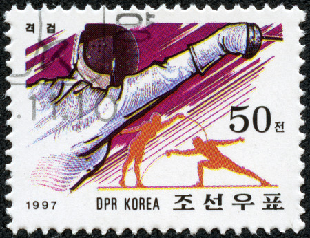 NORTH KOREA - CIRCA 1997  A stamp printed in North Korea showing fencing, circa 1997