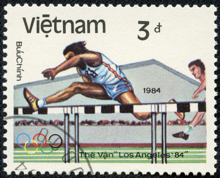 VIETNAM-CIRCA 1984  A stamp printed in the Vietnam, shows Hurdler, 1984 Olympic Games, Los Angeles, California, circa 1984