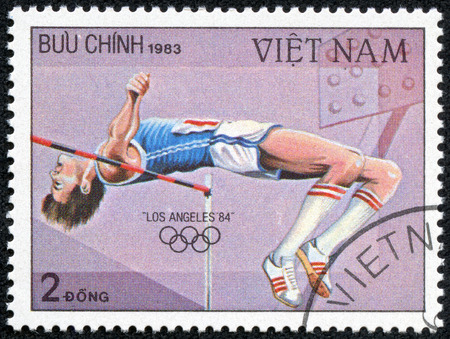 summer olympics: VIETNAM-CIRCA 1983  A stamp printed in the Vietnam, dedicated to the Summer Olympics in Los Angeles, shows High jump, circa 1983