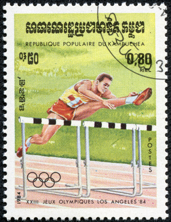 KAMPUCHEA-CIRCA 1984  A stamp printed in the Kampuchea, is dedicated to Summer Olympic Games in Los Angeles, Hurdler, circa 1984 Editorial