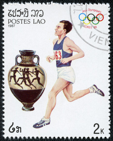 LAOS - CIRCA 1987  A stamp printed in Laos shows an athlethe Running, series Olympic Games in Seoul 1988, circa 1987