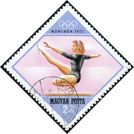 summer olympics: HUNGARY - CIRCA 1972  A stamp printed in Hungary, shows gymnastics balance beam  and Olympic Rings, with inscription and name of series  Olympic Games in Munich, 1972 , circa 1972