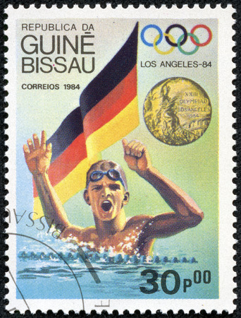 summer olympics: GUINEA-BISSAU - CIRCA 1984  A stamp printed in Guinea-Bissau showing Swimmer,The Los Angeles Olympics 1984,circa 1984