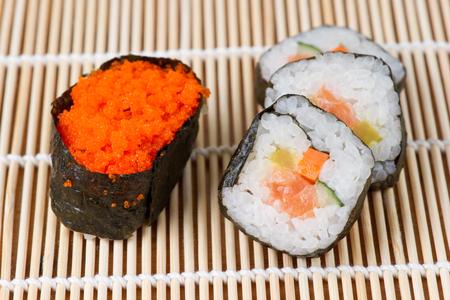 bamboo mat: Assorted sushi on bamboo mat