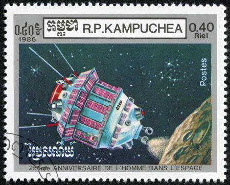 manned: Cambodia - CIRCA 1986  Postage stamps printed in Cambodia, dedicated to the 25th anniversary of manned flight into space, shows Satilate , circa 1986 Editorial