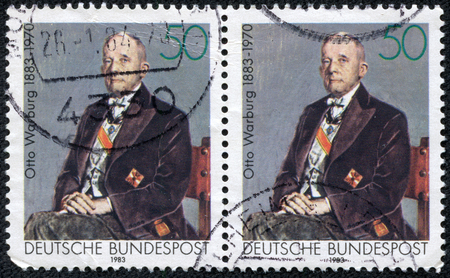 physiologist: GERMANY - CIRCA 1983  A stamp printed in Germany shows Otto Heinrich Warburg - German physiologist, medical doctor and Nobel laureate, circa 1983