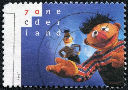comic duo: NETHERLANDS - CIRCA 1996  a postage stamp printed in Netherlands showing an image of Ernie and Bert two characters on Sesame Street tv program, circa 1996  Editorial