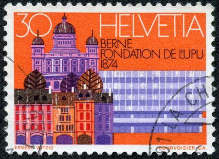 upu: SWITZERLAND - CIRCA 1974  a stamp printed in the Switzerland shows Old Houses, Parliament and RR Station, Bern, Centenary of the UPU, circa 1974 Editorial