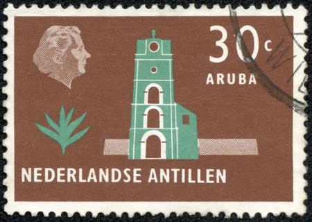 nederlan: NETHERLANDS ANTILLES - CIRCA 1958  A stamp printed in the Netherlands shows Church tower, Aruba, circa 1958  Editorial