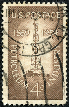 boring rig: USA - CIRCA 1959  Postage stamp printed in the USA, dedicated to the Centenary of the completion of the nation s 1st oil well at Titusville, Pa , shows an Oil Derrick, circa 1959 Editorial