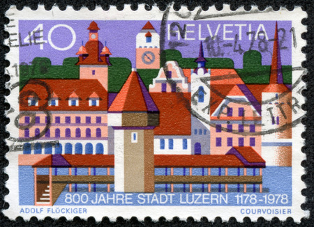 helvetia: SWITZERLAND - CIRCA 1978  A stamp printed in Switzerland dedicated to the 800th anniversary of the town of Lucerne shows landmark builldings from the city, circa 1978  Editorial
