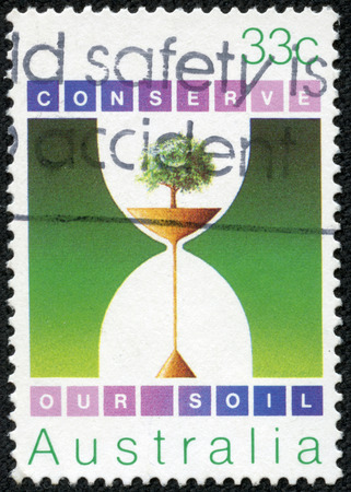 tree service pictures: AUSTRALIA - CIRCA 1985  a stamp printed in the Australia shows Hourglass, with Soil and Tree, Environmental Conservation, circa 1985 Editorial
