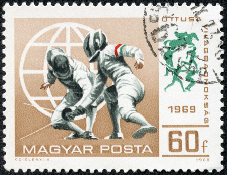 Hungary - CIRCA 1969  A stamp printed in Hungary shows a fencing competitions, circa 1969