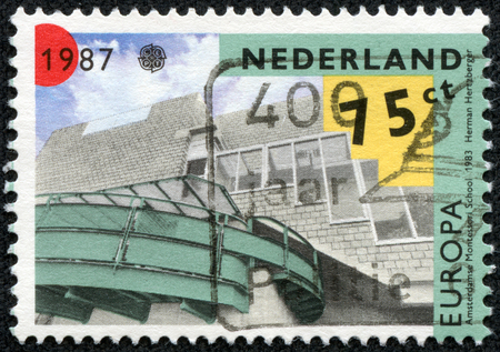 NETHERLANDS - CIRCA 1987  a stamp printed in the Netherlands shows Montessori School designed by Herman Hertzberger, Amsterdam, circa 1987