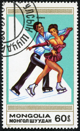 MONGOLIA - CIRCA 1989  A stamp printed by Mongolia shows the figure skating  Winter sports, series, circa 1989