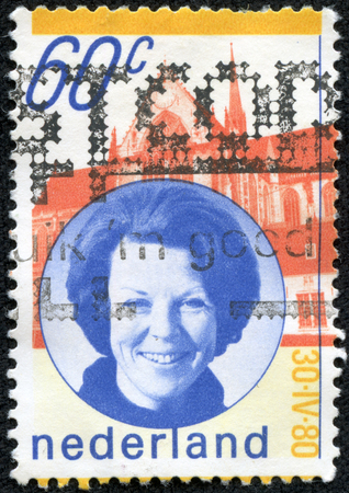 beatrix: NETHERLANDS - CIRCA 1980  A stamp printed in the Netherlands issued for the installation of Queen Beatrix shows Queen Beatrix and New Church, Amsterdam, circa 1980  Editorial