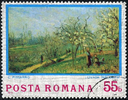 ROMANIA - CIRCA 1974  A stamp printed in Romania, shows picture  Orchard in Bloom  by Camille Pissarro, with the same inscription, from the series  Impressionist Paintings , circa 1974 Stock Photo