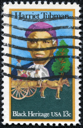 abolitionist: UNITED STATES OF AMERICA - CIRCA 1978  a stamp printed in the United States of America shows Harriet Tubman and Cart Carrying Slaves, circa 1978