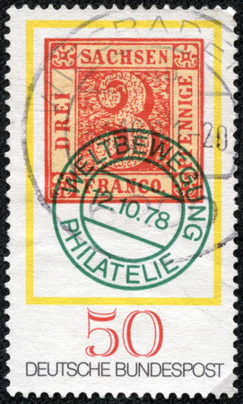 GERMANY - CIRCA 1978  A stamp printed in Germany from the  Stamp Day and World Philatelic Movement  issue shows an old 3pf  stamp of Saxony from 1850, circa 1978
