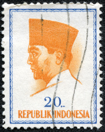sukarno: INDONESIA - CIRCA 1965  A stamp printed in Indonesia shows president Sukarno commemorating the 1965 Conference of New Emerging Forces, Djakarta  Conefo , circa 1965