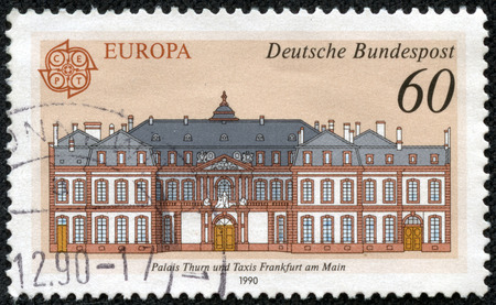 GERMANY - CIRCA 1990  A stamp printed in the Germany, is depicted Post offices in Frankfurt am Main  Thurn and Taxis Palace, circa 1990
