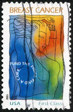 UNITED STATES - CIRCA 1998  a postage stamp printed in USA showing an image of a woman commemorating the fight against breast cancer, circa 1998