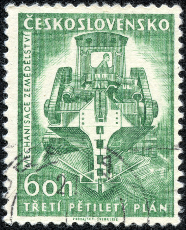 CZECHOSLOVAKIA - CIRCA 1961  A Stamp printed in Czechoslovakia shows image of ditch digging machine  Mechanisace Zemedelstvi , circa 1961