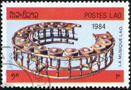 tuned: LAOS-CIRCA 1984  A stamp printed in the Laos, depicts a musical instrument Tuned drums, circa 1984